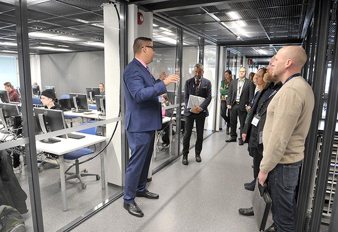Staff memeber introducing SAMK Campus Rauma for visitors.