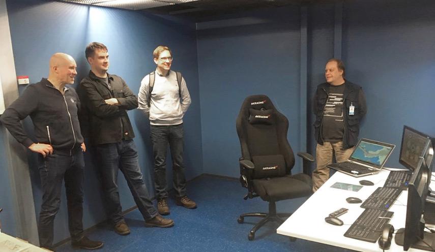 Four man exploring SAMK's maritime simulator.
