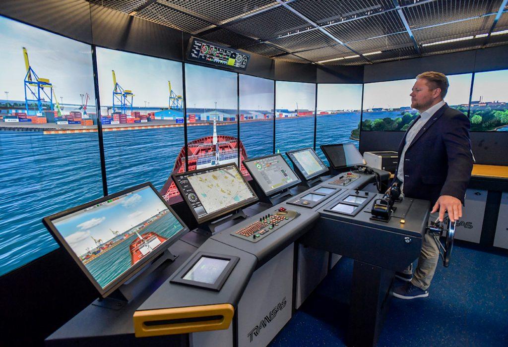 Marko Löytökorpi standing at maritime simulator.