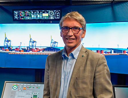 Sauli Ahvenjärvi stands front of simulations screens.